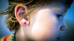 Miette showing me her new pierced ear.